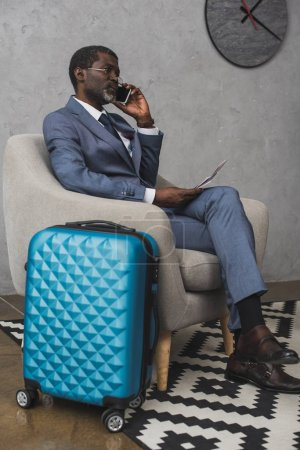 Businessman talking by smartphone