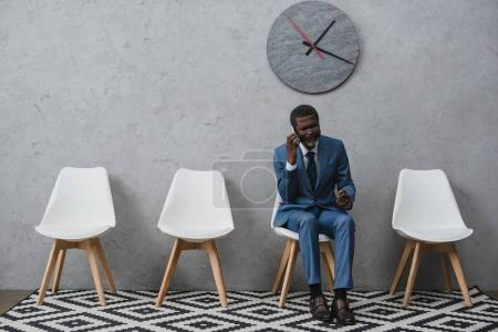 Businessman talking by smartphone