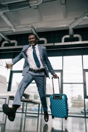 businessman running for flight
