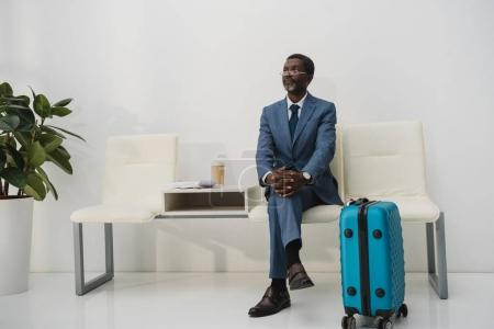 Photo for African american businessman waiting for departure at the airport - Royalty Free Image