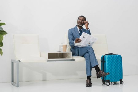 Businessman looking above glasses