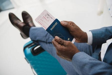 Man holding passport and fly ticket