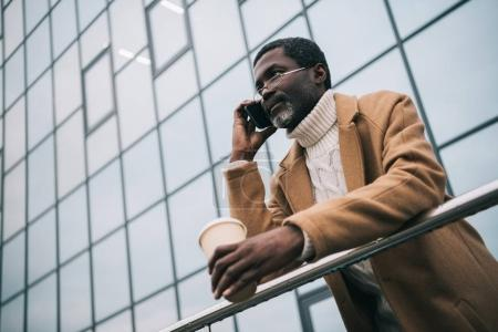 African american man talking by smartphone