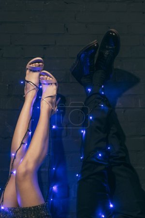 Couple with christmas lights on legs