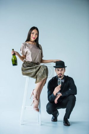 multiethnic couple with champagne