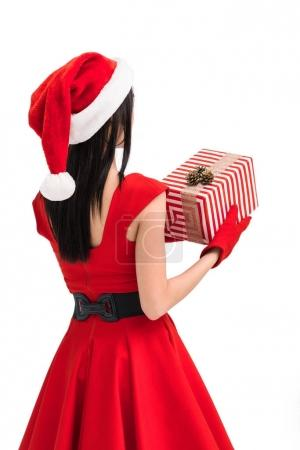 Woman in santa costume with gift