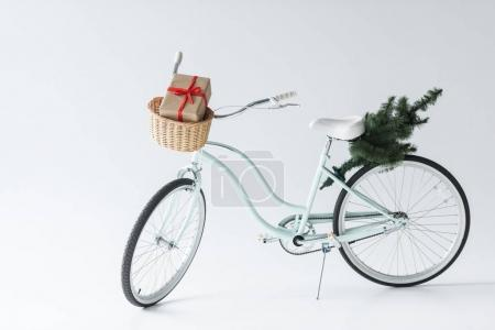 retro bicycle with christmas tree and gift