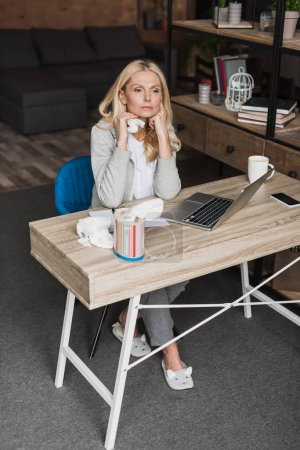 Sick woman using laptop