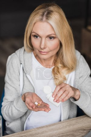 sick woman taking medicine