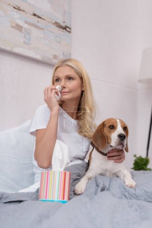 sick woman with dog at home