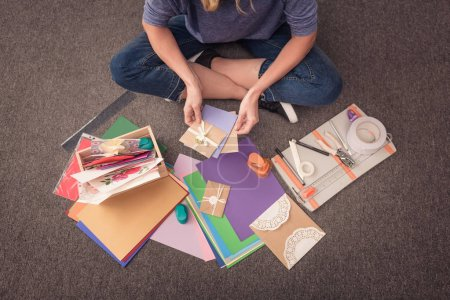 Woman paper crafting at home