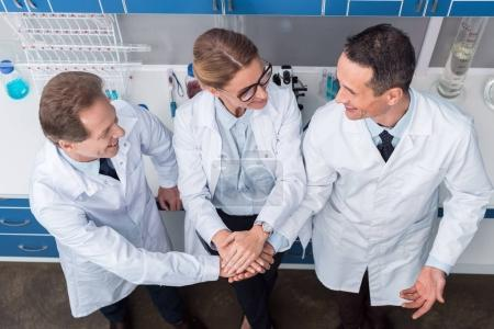 Scientists holding hands