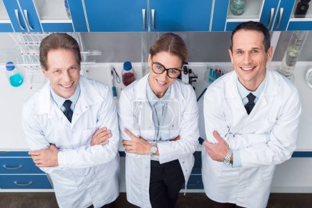 Photo for Smiling team of professional medical workers, posing with arms crossed and looking at camera - Royalty Free Image