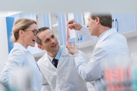Scientists examining test tube