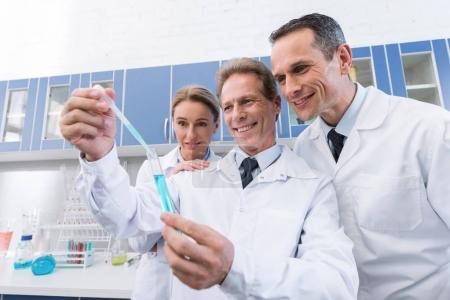Scientists making experiment with sample