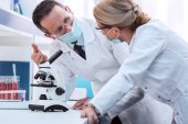 scientists doing microscope analysis