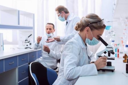 Chemist doing microscope analysis