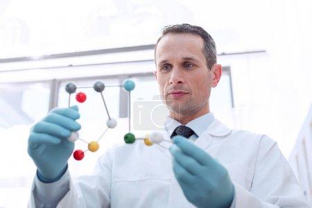 doctor examining molecular model