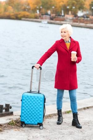 senior woman with suitcase