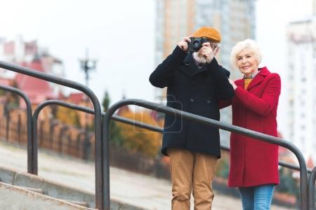 senior couple taking photo