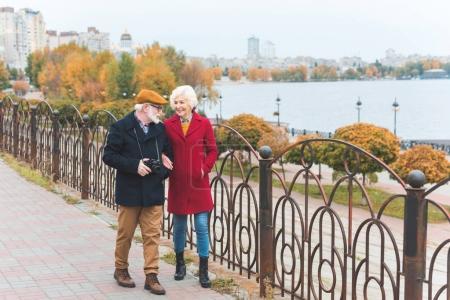 senior tourist couple on quay