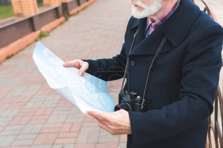 senior tourist with map