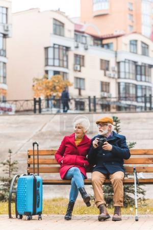 tourist couple on bench