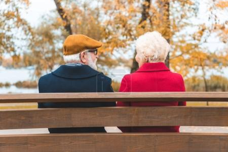 senior couple on bench in park