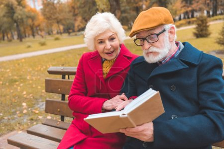 senior couple reading book