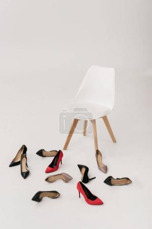 chair and high heeled shoes