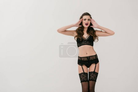 woman in black lingerie and stockings