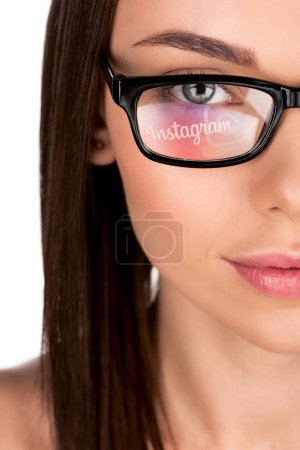 woman with instagram logo reflection in eyeglasses