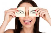 woman covering eyes with stickers