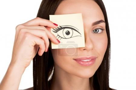 woman covering eye with sticker