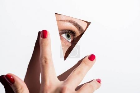 woman looking out of hole in paper