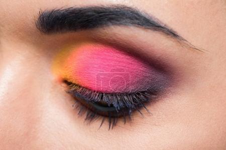young woman with colorful eyeshadows