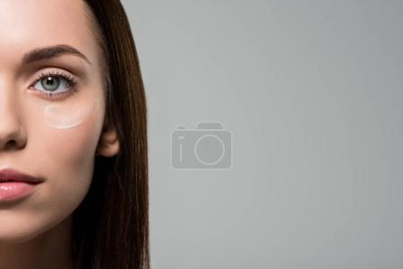woman with moisturizing cream on face