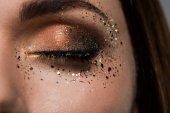 woman with gloss around eye