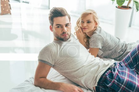 young couple in bedroom