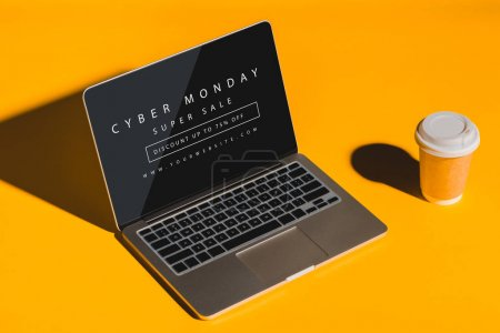 Photo for Disposable cup of coffee and laptop with blank screen on yellow - Royalty Free Image