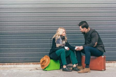 young couple with suitcases