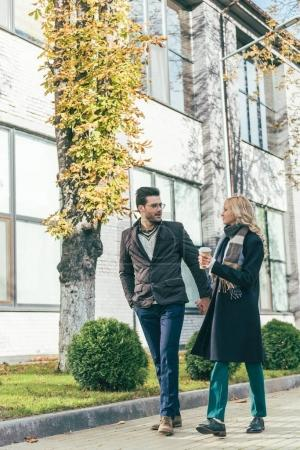 couple in autumn outfit walking together