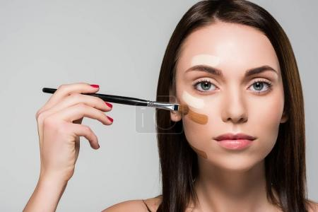 woman with tonal foundation on face
