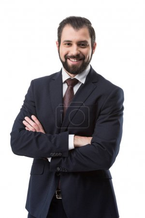 Photo for Cheerful bearded businessman in suit with crossed arms, isolated on white - Royalty Free Image