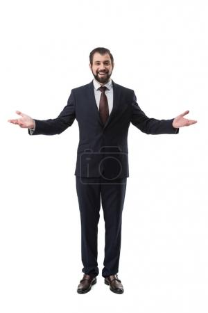Photo for Cheerful successful businessman in suit gesturing isolated on white - Royalty Free Image
