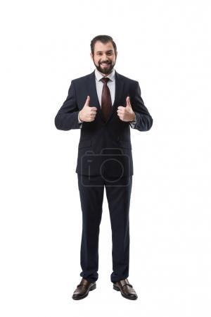 Foto de Empresario alegre en traje mostrando los pulgares para arriba, aislado sobre blanco - Imagen libre de derechos