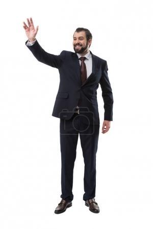 waving businessman in suit