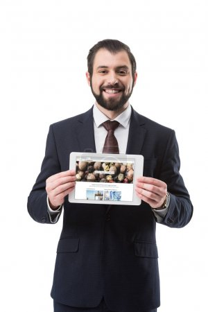 Photo for Smiling businessman showing digital tablet with depositphotos website, isolated on white - Royalty Free Image