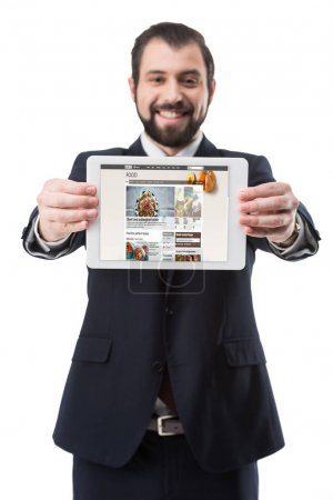 businessman showing digital tablet