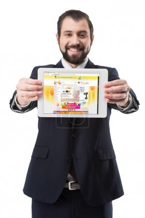 Photo for Smiling businessman showing digital tablet with aliexpress website, isolated on white - Royalty Free Image